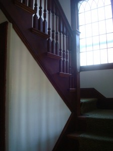 Front staircase that reminds me of being in church every time I use it